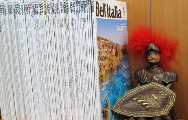 Bell'Italia magazines with Sicilian puppet